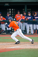Adam Haseley (7) of the Virginia Cavaliers follows through on his swing against the Seton Hall Pirates at The Ripken Experience on February 28, 2015 in Myrtle Beach, South Carolina.  The Cavaliers defeated the Pirates 4-1.  (Brian Westerholt/Four Seam Images)