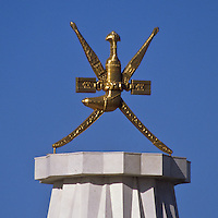 Omani Royal Emblem, Crossed Swords and a Curved Dagger (Khanjar).  Muscat, Oman.