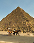 "Giza, Cairo, Egypt -- A horse-drawn carriage ""taxi"" waits for a tourist rider in the shadow of the Great Pyramid of Khufu (Cheops). © Rick Collier / RickCollier.com."