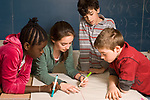 Education Elementary Grade 6 classroom math activity boys and girls working together on number line graph