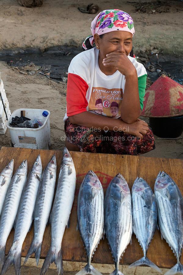 Jimbaran, Bali, Indonesia.  Woman Selling Fish on the Beach, early Morning.