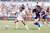 CARY, NC - SEPTEMBER 12: Crystal Dunn #19 of the Portland Thorns FC is defended by Abby Erceg #6 of the North Carolina Courage during a game between Portland Thorns FC and North Carolina Courage at Sahlen's Stadium at WakeMed Soccer Park on September 12, 2021 in Cary, North Carolina.