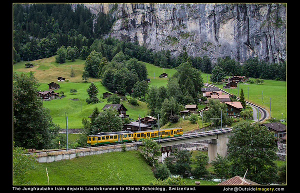 Switzerland, Eiger.  Light: Think Simply. <br /> Light is either sunny with shadows or cloudy without shadows. When there are no shadows, you can point the camera in any direction and have very similar lighting conditions. This diffuse or soft light yields wonderful color saturation and detail. The railroad's diagonal lines to leads the viewer into and through the photo.<br /> The Jungfraubahn train departs Lauterbrunnen on its way to Kleine Scheidegg, then the Jungfraujoch Observatory.