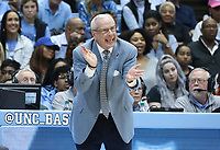 CHAPEL HILL, NC - FEBRUARY 25: Head coach Roy Williams of the University of North Carolina encourages his team during a game between NC State and North Carolina at Dean E. Smith Center on February 25, 2020 in Chapel Hill, North Carolina.