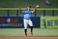 Guerreros de Fayetteville third baseman Yeuris Ramirez (20) catches a pop fly during the game against the Rapidos de Kannapolis at Atrium Health Ballpark on June 24, 2021 in Kannapolis, North Carolina. (Brian Westerholt/Four Seam Images)