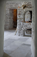 A view into one of the bedrooms with its restored open fireplace