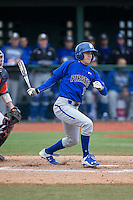 Jackson Martin (16) of the Seton Hall Pirates follows through on his swing against the Virginia Cavaliers at The Ripken Experience on February 28, 2015 in Myrtle Beach, South Carolina.  The Cavaliers defeated the Pirates 4-1.  (Brian Westerholt/Four Seam Images)