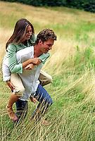 Young man giving a woman a piggy back ride&#xA;&#xA;<br />