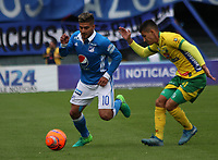 BOGOTA -COLOMBIA, 30-04-2017. Jacobo Kouffatty (L) player of Millonarios fights the ball agaisnt Ronaldo Tavera (R) player of Atletico Huila Action game between  Millonarios  and Atletico Huila during match for the date 15 of the Aguila League I 2017 played at Nemesio Camacho El Campin stadium . Photo:VizzorImage / Felipe Caicedo  / Staff