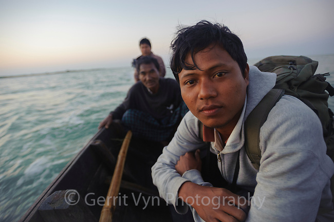 Conservationsist Ren Noung Soe and local men on their way to  Nan Thar Island where they are working to protect critically endangerednSpoon-billed Sandpipers from subsistence bird hunters. Rakhine State, Myanmar. January.