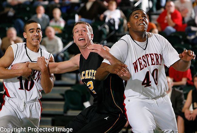 SPEARFISH, SD - DECEMBER 30:  Will John Johnson #32 (center) battles for position during free throw with Brandon Brown #10 and JaRon Brown #40 of the University of Montana Western during their game Wednesday at the Perkins Basketball Classic at the Donald E. Young Center in Spearfish, S.D.  (Photo by Dick Carlson/Inertia)