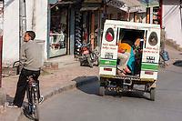 "Nepal, Kathmandu.  A ""Tuk-tuk"", a Three-wheeled Taxi."