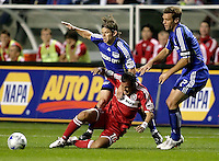 Chicago Fire midfielder Cuauhtemoc Blanco (10) is fouled by Kansas City Wizards defender Lance Watson (6) while teammate Jimmy Conrad (12) looks on.  The Chicago Fire tied the Kansas City Wizards 2-2 at Toyota Park in Bridgeview, IL on April 18, 2009.