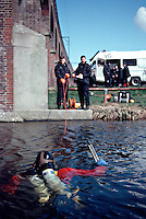 Police underwater diving unit searching a river for evidence. Here the diver has found a shot gun used in a crime, he will hand it over to a police officer on the bank...© SHOUT. THIS PICTURE MUST ONLY BE USED TO ILLUSTRATE THE EMERGENCY SERVICES IN A POSITIVE MANNER. CONTACT JOHN CALLAN. Exact date unknown.john@shoutpictures.com.www.shoutpictures.com..