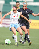 Allie Long #9 of the Washington Freedom loses the ball to Natalie Spillger #13 of the Chicago Red Stars during a WPS match at RFK stadium on June 13 2009 in Washington D.C. The game ended in a 0-0 tie.