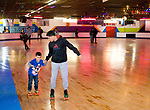 WATERBURY, CT-122717JS10----Giovanni Torres, 17, helps his brother Rafael Santiago, 5, around the rink during an anti-violence program Thursday at Roller Magic in Waterbury. The event was sponsored by Let's Go Youth United and Connecticut Against Violence of Bridgeport. More than 100 local students were selected to participate in the event. <br />  Jim Shannon Republican-American
