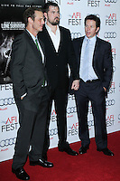 """HOLLYWOOD, CA - NOVEMBER 12: Peter Berg, Marcus Luttrell, Mark Wahlberg at the AFI FEST 2013 - """"Lone Survivor"""" Premiere held at TCL Chinese Theatre on November 12, 2013 in Hollywood, California. (Photo by David Acosta/Celebrity Monitor)"""