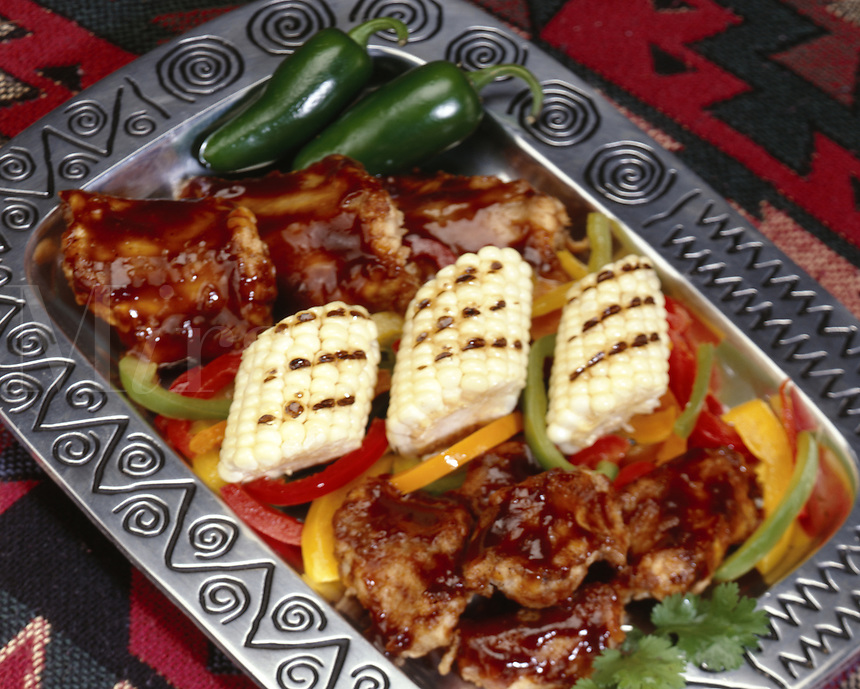 Barbeque Rattlesnake with red, yellow, orange and green pepper and grilled corn