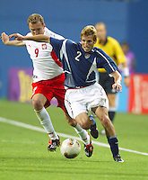 Frankie Hejduk shields a Polish defender from the ball. The USA lost 3-1 against Poland in the FIFA World Cup 2002 in Korea on June 14, 2002.