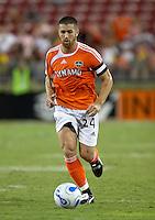 Houston Dynamo defender Wade Barrett dribbles downfield.  Houston Dynamo and Chivas USA drew to a 0-0 tie at Robertson Stadium in Houston, TX on September 17, 2006.