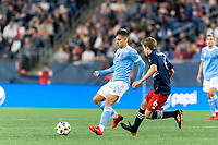 FOXBOROUGH, MA - SEPTEMBER 11: Nicolas Acevedo #26 of New York City FC dribbles as Scott Caldwell #6 of New England Revolution closes during a game between New York City FC and New England Revolution at Gillette Stadium on September 11, 2021 in Foxborough, Massachusetts.