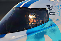 Feb 7, 2020; Pomona, CA, USA; The sun shines onto the face of NHRA top fuel driver Leah Pruett during qualifying for the Winternationals at Auto Club Raceway at Pomona. Mandatory Credit: Mark J. Rebilas-USA TODAY Sports