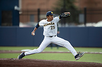 Michigan Wolverines pitcher Isaiah Paige (25) delivers a pitch to the plate in the NCAA baseball game against the Michigan State Spartans on May 7, 2019 at Ray Fisher Stadium in Ann Arbor, Michigan. Michigan defeated Michigan State 7-0. (Andrew Woolley/Four Seam Images)