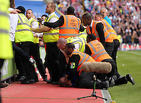 Pictured: A Swansea supporter is pinned to the ground by security stewards<br /> Re: Premier League match between Crystal Palace and Swansea City at Selhurst Park on May 24, 2015 in London, England, UK