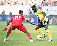 PHILADELPHIA, PA - JUNE 30: Kemar Lawrence #20 attacks against Edgar Barcenas #10 during a game between Panama and Jamaica at Lincoln Financial Field on June 30, 2019 in Philadelphia, Pennsylvania.