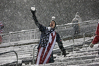Under a heavy snowfall, a USA fan celebrates the USA Men's National Team's World Cup Qualifier victory against Costa Rica at Dick's Sporting Good Park in Commerce City, CO on March 22, 2013.