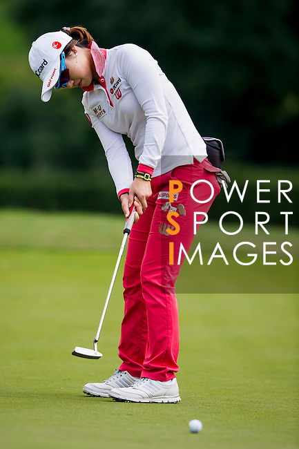 Hye Youn Kim of Korea in action during the Hyundai China Ladies Open 2014 Pro-am on December 10 2014, in Shenzhen, China. Photo by Li Man Yuen / Power Sport Images
