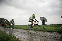 bad day on the bike for Alberto Contador (ESP/Tinkoff-Saxo), who didn't seem comfortable riding the cobbles<br /> <br /> 2014 Tour de France<br /> stage 5: Ypres/Ieper (BEL) - Arenberg Porte du Hainaut (155km)
