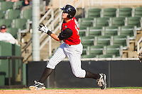 Ryan Hamme #14 of the Kannapolis Intimidators follows through on his swing against the Hickory Crawdads at Fieldcrest Cannon Stadium on April 17, 2011 in Kannapolis, North Carolina.   Photo by Brian Westerholt / Four Seam Images