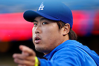 Hyun-Jin Ryu #99 of the Los Angeles Dodgers watches a game against the Atlanta Braves at Dodger Stadium on June 6, 2013 in Los Angeles, California. (Larry Goren/Four Seam Images)