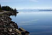 Tourists enjoy an early morning view of Yellowstone Lake from the Grand Loop Road in Yellowstone National Park, Wyoming on Tuesday, May 23, 2017. (Photo by James Brosher)