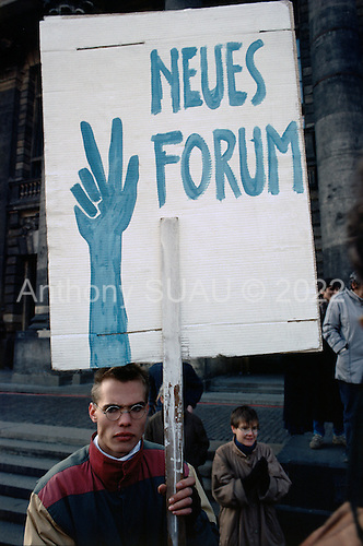 East Berlin, East Germany <br /> November 17, 1989 <br /> <br /> East Germans at an anti-government demonstration. Germans gathered at the wall dismantling it after the East German government lifted travel and emigration restrictions to the West.