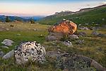 setting sun lights rocks along the high lakes trail in the absaroka beartooth wilderness area