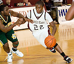 WATERBURY, CT- 02 JAN 2008- 010208JT08-<br /> Sacred Heart's Terrence Love dribbles past Holy Cross' Mark Redding during Wednesday's game at Sacred Heart. Cross remains undefeated, beating Sacred Heart 61-46. <br /> Josalee Thrift / Republican-American