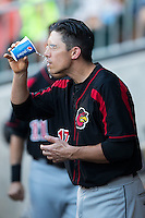 Doug Bernier (17) of the Rochester Red Wings cools off with a cup of water to the face during the game against the Charlotte Knights at BB&T BallPark on August 8, 2015 in Charlotte, North Carolina.  The Red Wings defeated the Knights 3-0.  (Brian Westerholt/Four Seam Images)