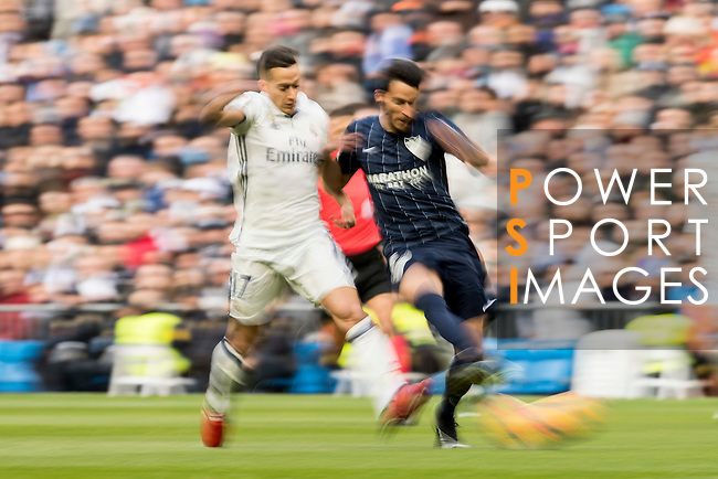 Lucas Vazquez (l) of Real Madrid fights for the ball with Juan Carlos Perez Lopez, Juankar, of Malaga CF during their La Liga 2016-17 match between Real Madrid and Malaga CF at the Estadio Santiago Bernabéu on 21 January 2017 in Madrid, Spain. Photo by Diego Gonzalez Souto / Power Sport Images