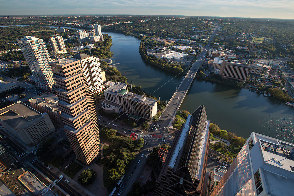 Late afternoon find a birds Eye view of Lady Bird Lake and the Congress Ave. Bridge from atop of the magestic Austin Skyline.