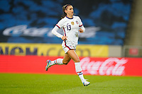 SOLNA, SWEDEN - APRIL 10: Alex Morgan #13 of the United States enters the field during a game between Sweden and USWNT at Friends Arena on April 10, 2021 in Solna, Sweden.