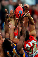 Australian Football League Grand Final, West Coast Eagles v Sydney Swans. Hands make a desperate grab for the ball in the dying seconds of the game.