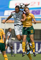 USWNT forward (20) Abby Wambachgoes up for a header with Australia's (32) Ellyse Perry during the Peace Queen Cup  in Suwon, South Korea.  The U.S. defeated Australia, 2-1, at the Suwon Sports Complex.