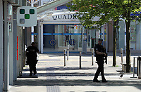 Pictured: An armed police officer in Union Street in Swansea city centre with the entrance to the Quadrant in the background Wednesday 24 May 2017<br /> Re: The Quadrant shopping centre in Swansea has been evacuated following reports of a suspicious package being found.<br /> The bus station and Swansea Indoor Market have also been closed as part of the evacuation.