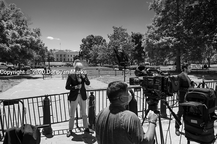 Washington, DC June 1, 2020 - A news crew from RTL prepares to report from Lafayette Park, across from the White House George.