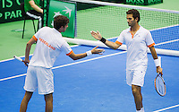 06-04-13, Tennis, Rumania, Brasov, Daviscup, Rumania-Netherlands,Jean-Julien Rojer and Robin Haase(l) in the dubbles