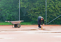 August 24, 2014, Netherlands, Amstelveen, De Kegel, National Veterans Championships, Preparing the clay courts after rainfall<br /> Photo: Tennisimages/Henk Koster