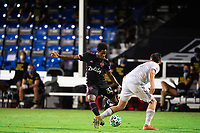 LAKE BUENA VISTA, FL - JULY 27: Joevin Jones #33 of the Seattle Sounders kicking the ball during a game between Seattle Sounders FC and Los Angeles FC at ESPN Wide World of Sports on July 27, 2020 in Lake Buena Vista, Florida.