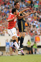 Sebastien Le Toux (9) of the Philadelphia Union and Fabio (20) of Manchester United go up for a header. Manchester United (EPL) defeated the Philadelphia Union (MLS) 1-0 during an international friendly at Lincoln Financial Field in Philadelphia, PA, on July 21, 2010.
